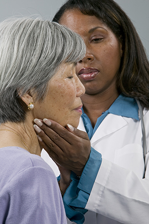 Doctor examining patient's neck.