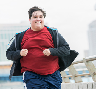 Overweight man jogging outdoors